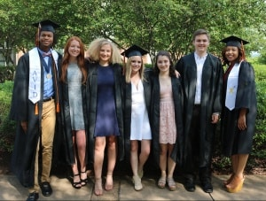 Group of graduates gather outside of JPJ Arena