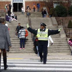 crossing guard helping students