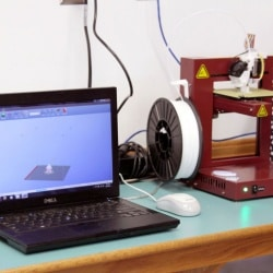 Printing robot keychains we designed using Thingiverse and Afinia 3-D design software