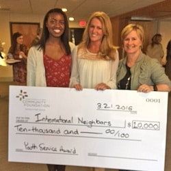 Teachers with a check to the International Neighbors