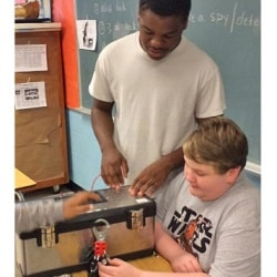 students working with a cold-war button model