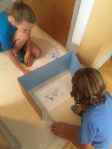 "Clark students playing ""longitude-latitude"" battleship"
