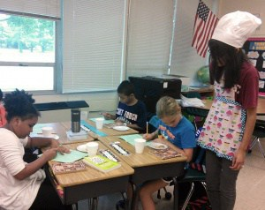"Students ""taste-testing"" books at Greenbrier"