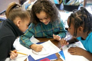 Burnley-Moran students responding to their senior pen pals. Photo courtesy Ryan M. Kelly/Daily Progress