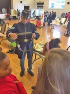 Students meeting with military re-enactors on Veterans Day