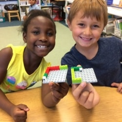 Students working together with Legos