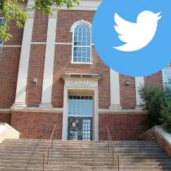 Image of Clark School facade with the Twitter logo superimposed on it