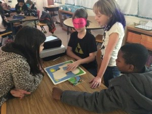 Walker students solving puzzles blindfolded with help from friends