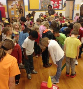 Students Taking a bow at a school-wide Venable meeting.