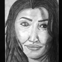 Artwork by Charlottesville High School 11th grade student, Waheda Haidari. Black and white portrait of a woman.