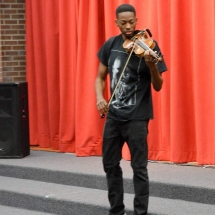 Photo of Violinist Eric Stanley During His Visit to Jackson-Via Elementary School