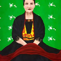 portrait of an elegant woman dressed in black on a green background