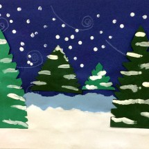 appliqué winter scene with evergreen trees in the snow