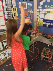 Kindergartners choosing the engineering station during center time.