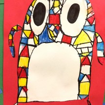 student artwork depicting a multi-colored owl