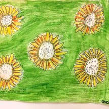 student artwork depicting sunflowers on a green background