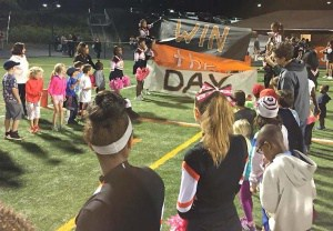 Elementary kids cheer on the Black Knights.