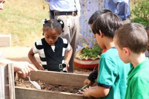 Children working in Johnson Elementary's schoolyard garden.