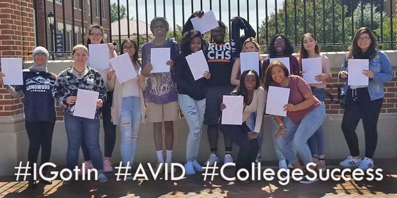 AVID students pose at Longwood University with their college admissions offers.