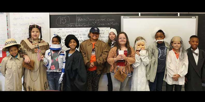 Clark students posing in costume for Historical Figure Day.