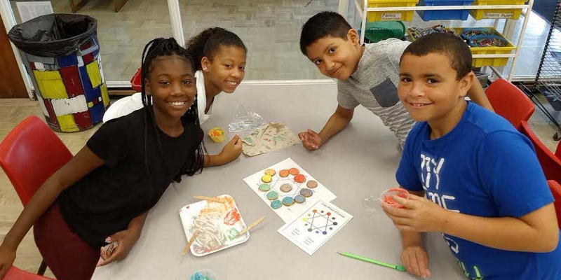 Students make color wheels.
