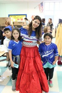 A family wearing native attire at International Day
