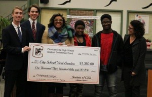 Student Investment club makes donation to City Schoolyard Garden at December School Board Meeting.