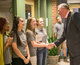 CFA Institute CEO and President Paul Smith shaking hands with AVID ushers. Photo courtesy CFA Institute.