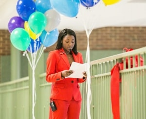 Dyshe Smith '18 tells of her success with the AVID program at the ribbon-cutting for our partnership with CFA Institute. Photo courtesy CFA Institute.