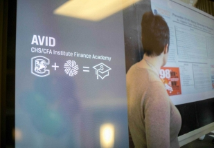 Monitor outside the classroom supporting AVID and Student Investment Group. Lucas Higgins '18, founder of the Student Investment Group. Photo courtesy CFA Institute.