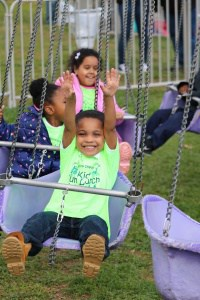 PreK student enjoys Dogwood Festival carnival ride.