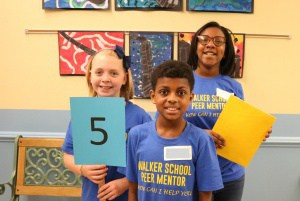 Peer mentors give tours to rising fifth graders.