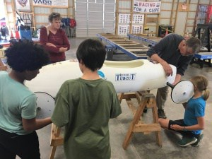 Walker students work on derby car.