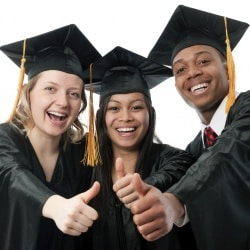 Three students wearing graduation gowns on a white background