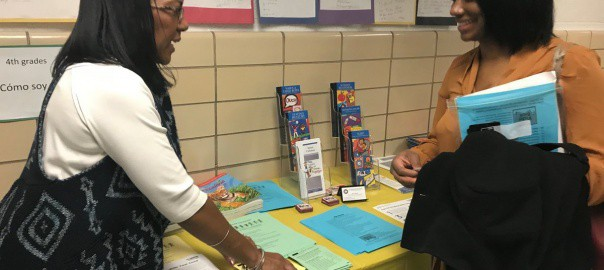 Family Engagement Facilitator Velvet Coleman (left) talks with a mother at Johnson