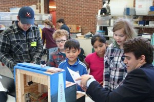 UVA student engineers test designs with Walker 5th grade students.