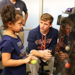 UVA student plays game with Clark kindergartener.