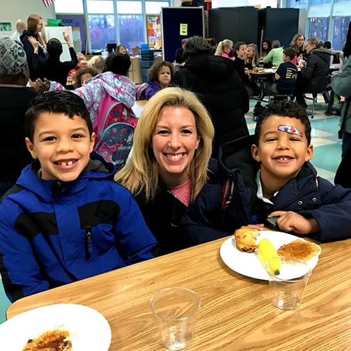 Mom with two boys at Muffins with Moms