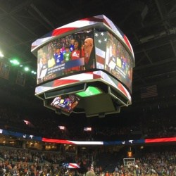 Venable students singing the national anthem on the jumbotron at the UVA Women's Basketball game.