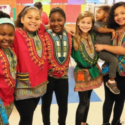 Students pose for picture in colorful tunics at Walker International Day.