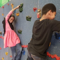 Students on climbing wall at Johnson Elementary.