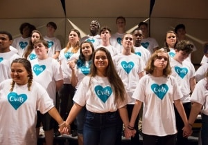 "CHS musicians on stage holding hands wearing ""Cville"" tshirts"