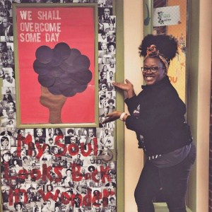 Teacher shows her classroom door decorations for Black History Month
