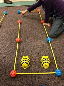 Bee-bot robots set up on a course at iSTEM night.
