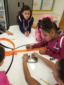 "Clark students working on a design challenge with ""Hot Wheels"" track"