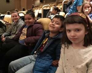 Third-graders waiting for a performance at the Paramount Theatre