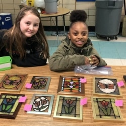 Third-graders with their wares at market day.