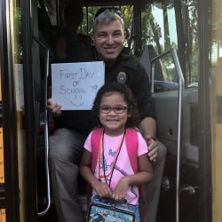 School SRO officer with child on first day of school