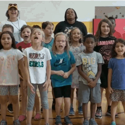 Screenshot of children in the Family Engagement Attendance Matters video