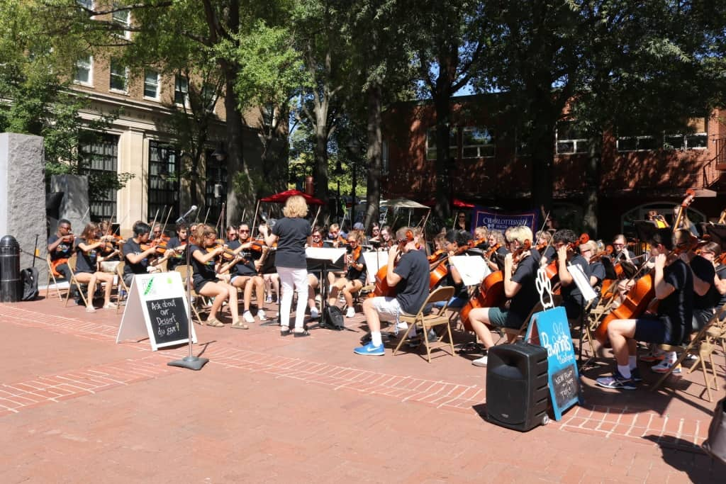 CHS orchestra strings ensemble performing on Downtown Mall.